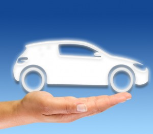 Car icon held in the palm of a hand