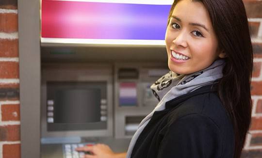 Girl using an ATM