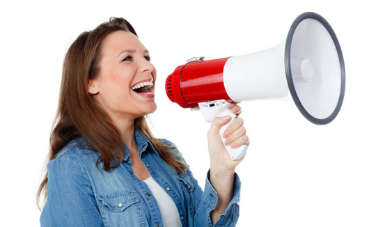 woman shouting happily through a megaphone